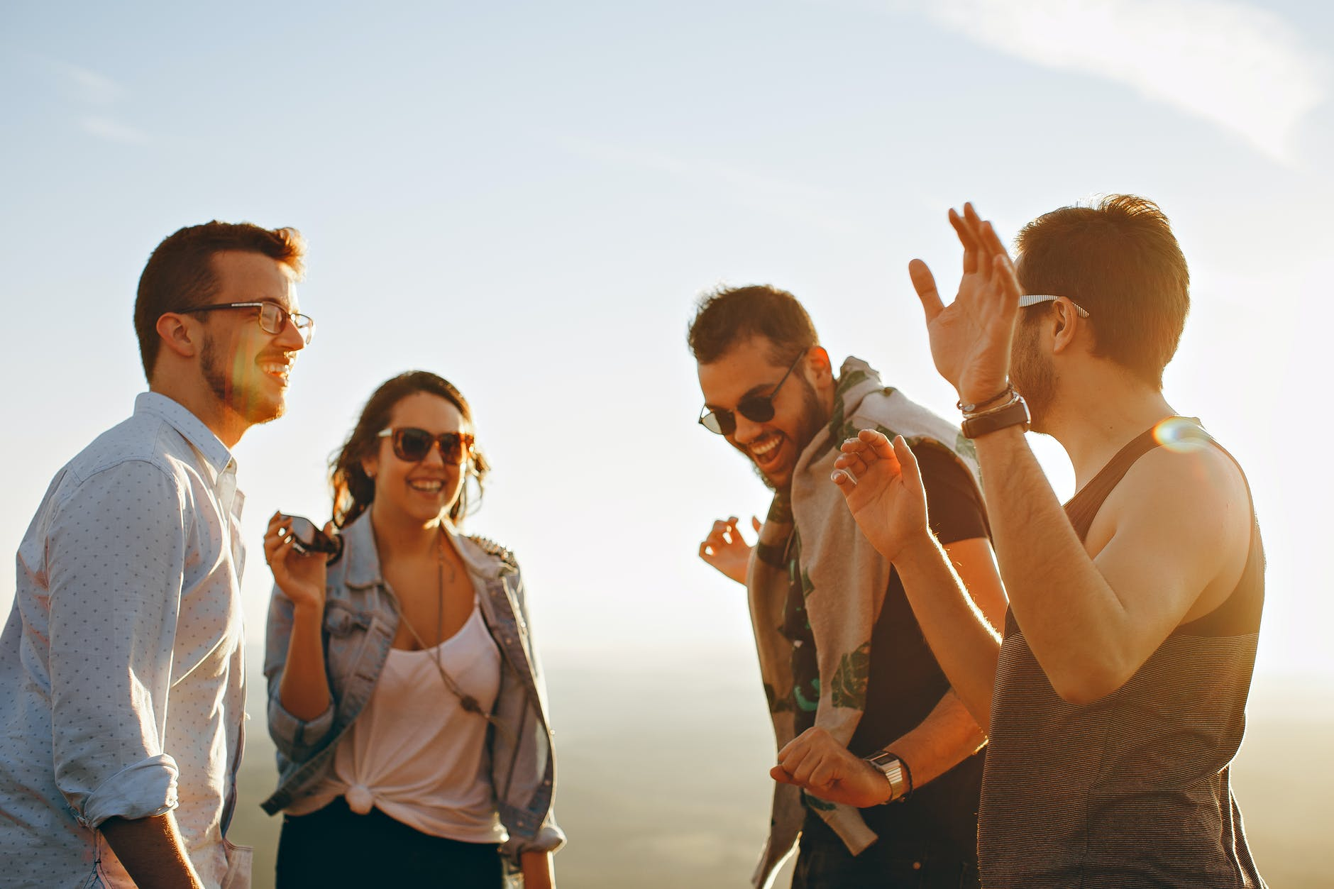 group of people having fun together under the sun