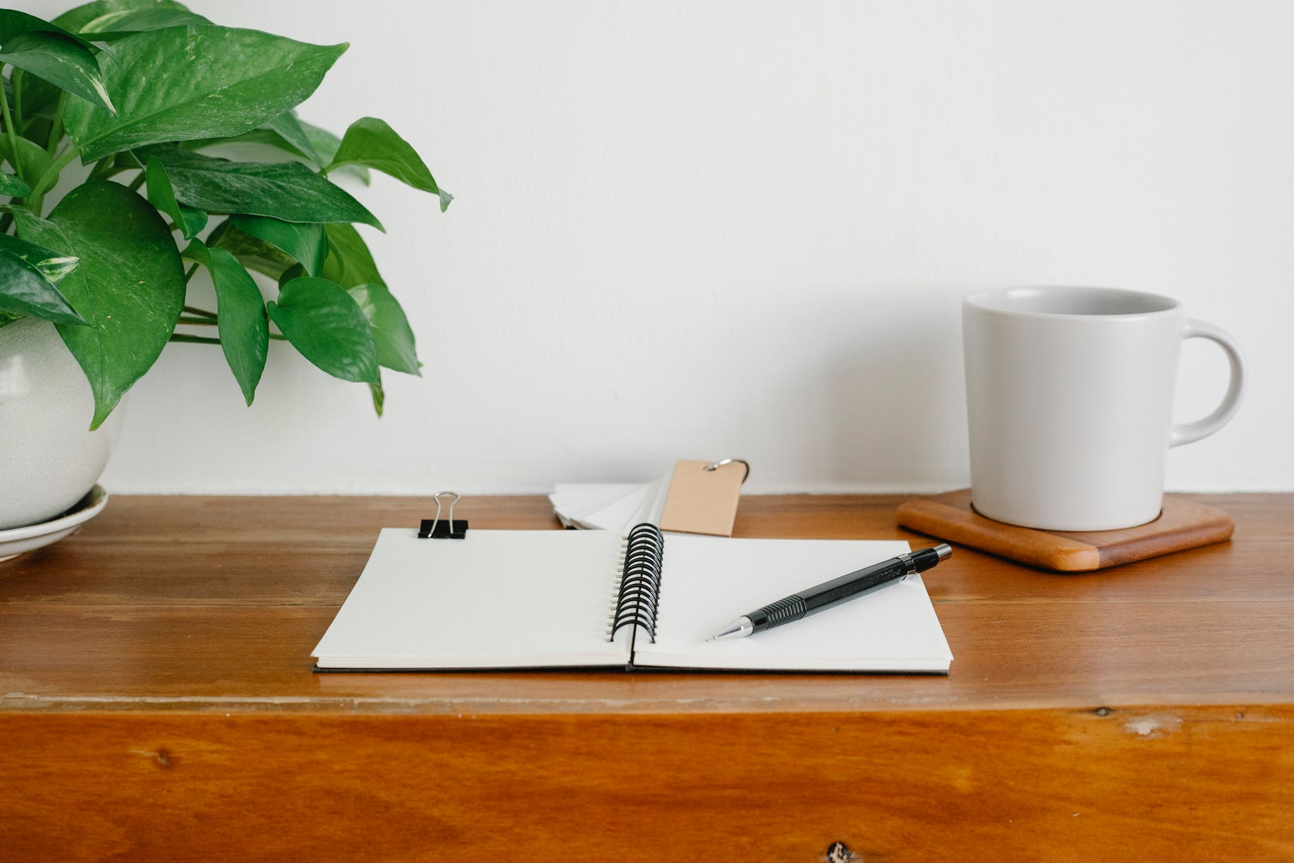 table with stationery in workspace